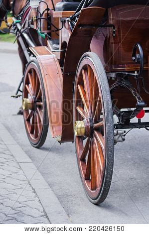 Close view of  an antique carriage wheels.