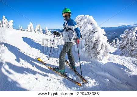 Man skier on a slope in the beautiful mountain view.