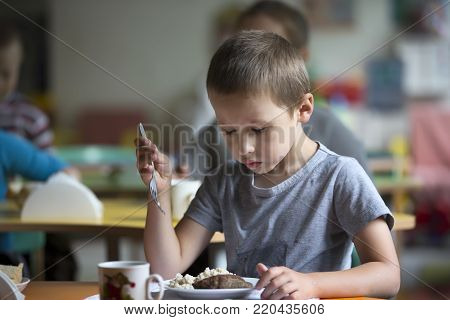 Boy child does not want to eat. Bad appetite. Eating in kindergarten