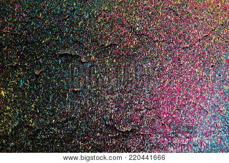 Very colorful abstract paint splatter background. Aerosol art paint splatter texture.