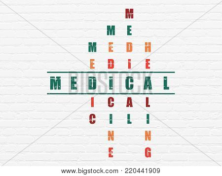 Medicine concept: Painted green word Medical in solving Crossword Puzzle