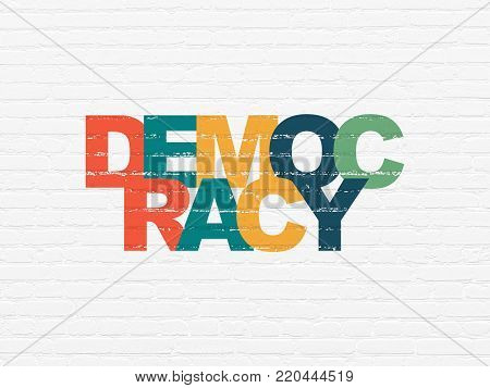 Politics concept: Painted multicolor text Democracy on White Brick wall background