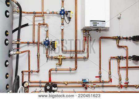 Heating system with copper pipes, valves and other equipment in a boiler room