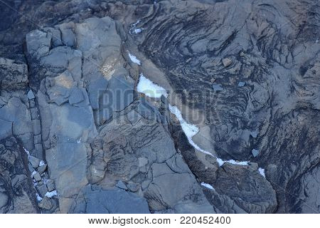 Closeup abstract blue and orange shale stone texture background.