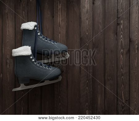 Skates hang on a old wooden wall