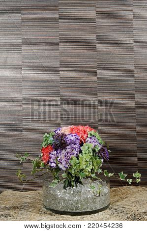 beautiful bouquet of mixed flowers in a glass vase