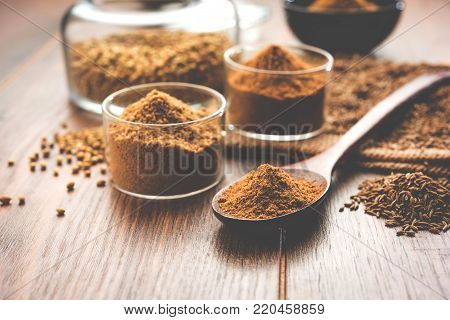 cumin seeds or Jeera powder (Ground cumin ), selective focus