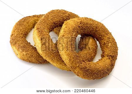 Three Simits Turkish bagel isolated on white background