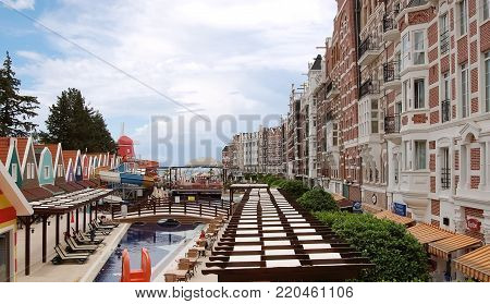 Kemer, Turkey - May 30, 2015: View to the street with a pool and original buildings in the style of Amsterdam architecture of the 16th century in the modern hotel Orange County Resort, Turkey.