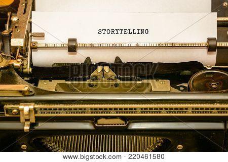 STORYTELLING - written on old typewriter machine - capital letters