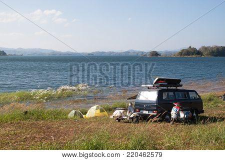 KANCHANABURI, THAILAND - JANUARY 2, 2018 : Camping travel by van and vespa at Pom Pee, Khao Laem National Park, Kanchanaburi, Thailand