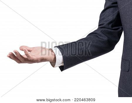 Man in business suit shows outstretched hand with open palm. Isolated on white.