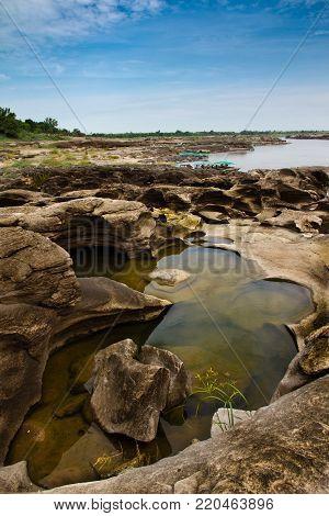 Unique nature erosion stone Sam Phan Bok in Ubon Ratchathani Thailand poster