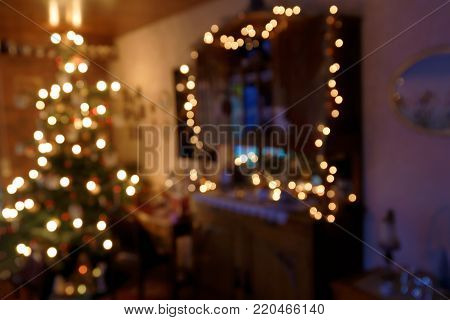 Bokeh Background - Atmospherically illuminated Family Room in Christmas Time