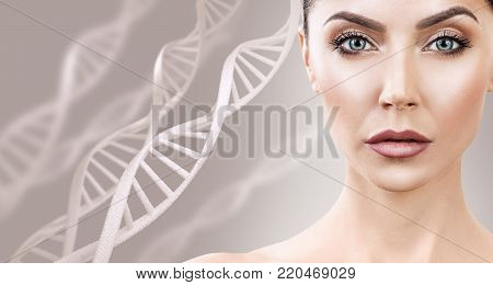 Adult sensual woman among DNA chains over beige background. Biochemistry skin concept.