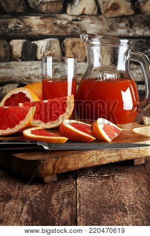 Grapefruit Juice And Ripe Grapefruits On A Wooden Background