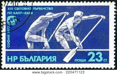 Ukraine - circa 2018: A postage stamp printed in Bulgaria shows drawing Doubles Canoeing. Series: 13th Canoe World Championships. Circa 1977.
