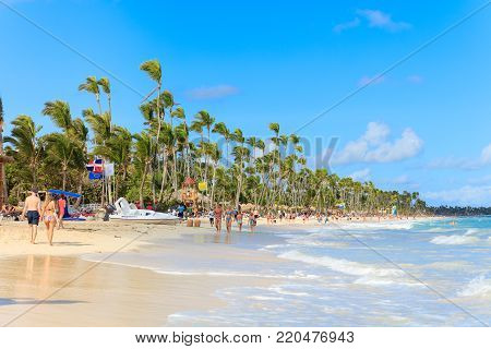 Punta Cana, Dominican Republic - December, 2017: tourists relaxing on sunny beach