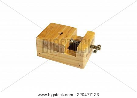 Small wooden vise. Close-up. Isolated on white background.