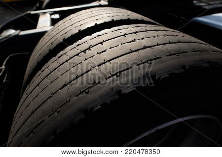 Heavy Truck Tire Tread Wear Closeup Photo. Trucking Industry and Safety on the Road.