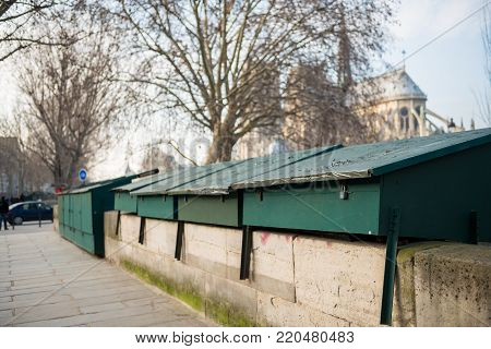 Closeup on locked cabins of secondhand bookseller on the edge of Seine in Paris
