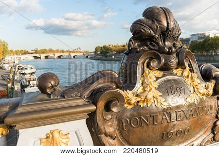 View on Alexandre the third bridge in Paris, above the river Seine with boats