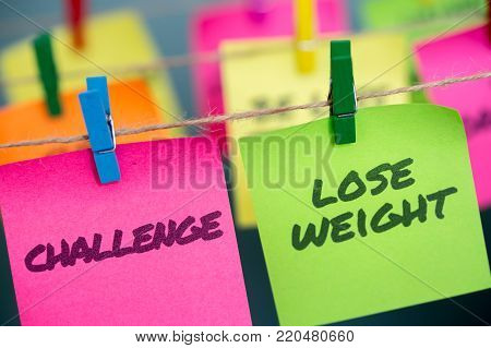 Closeup notes concept for motivation for challenge to lose weight