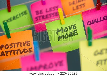 Closeup notes concept for motivation for move more to stay healthy or lose weight