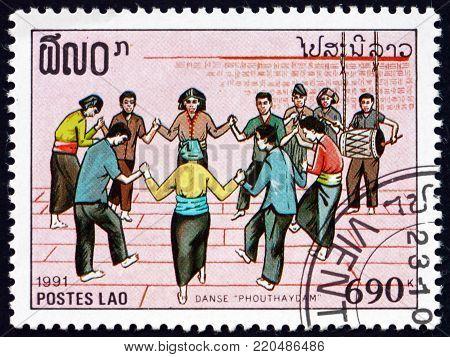 LAOS - CIRCA 1991: a stamp printed in Laos shows people dancing, musical celebration, circa 1991