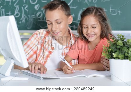 Two pupils working together in computer class