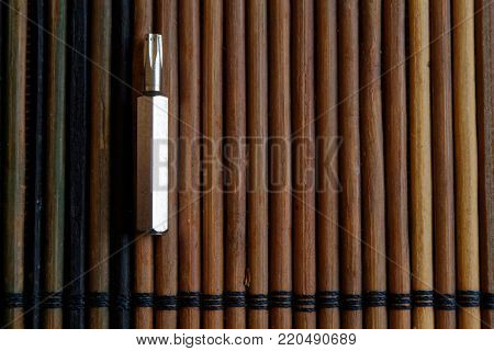 Head for screwdriver (bits) on wooden background, Tools collection turn-screw