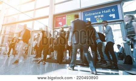 Business people rushing in a entrance of a trade show center. ideal for websites and magazines layouts