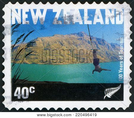 NEW ZEALAND - CIRCA 2001: a stamp printed in the New Zealand shows Bungee Jumper, Queenstown, Government Tourist Office, Centenary, circa 2001