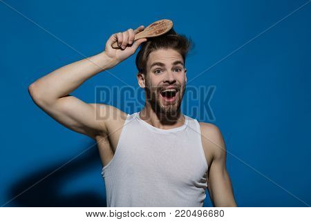 Happy Man Brush Hair With Hairbrush On Blue Background