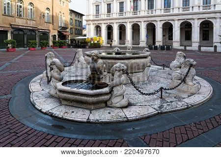 BERGAMO, ITALY - DECEMBER 24, 2016: The fountain of the Piazza Vecchio in the old town of Bergamo, Italy on December 24, 2016