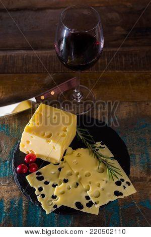 Dessert With Medium-hard Mild Swiss Cheese Emmental And Glass Red Wine