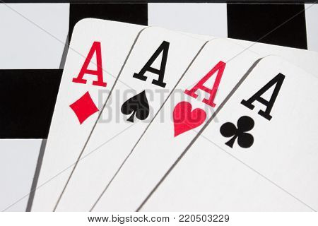four aces on a chessboard a strong combination of playing cards