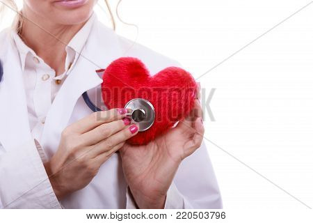 Medical examination of cardiology. Cardiologist with heart and stethoscope. Female doctor in white uniform makes measurement heartbeat. Isolated on white.