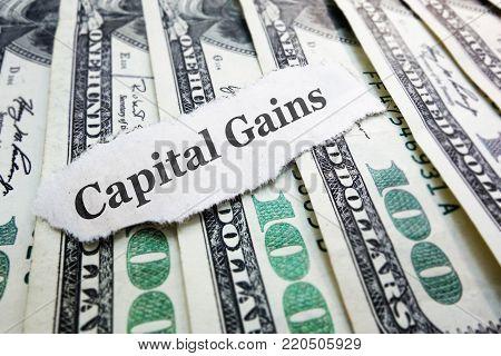 Capital Gains newspaper scrap on assorted money