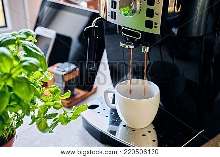 Professional coffee machine for home use and communication set of smart watch, tablet PC and smart phone.