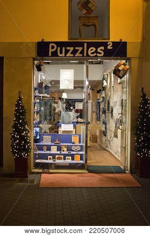 PALMA DE MALLORCA, BALEARIC ISLANDS, SPAIN - DECEMBER 5, 2017: Puzzles store with evening Christmas light decorations on December 5, 2017 in Palma de Mallorca, Balearic islands, Spain.