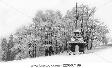 Wooden chapel in winter with snow in Beskydy mountains, Czech Republic