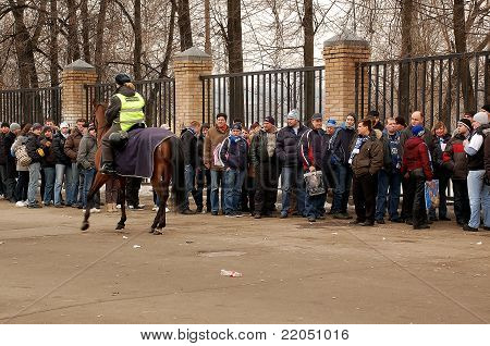 Mounted Policewoman And Soccer Fans