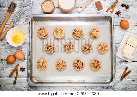 Cooking cinnamon rolls. Preparation raw dough traditional sweet dessert buns danish pastry. Baking ingredients flat lay. Top view