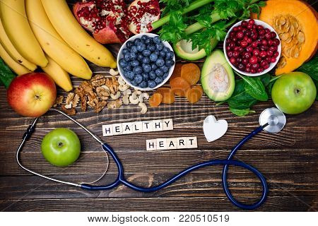 Healthy food for heart. Healthy heart concept. Healthy food, diet and life. Fresh fruits and vegetables, berries and nuts