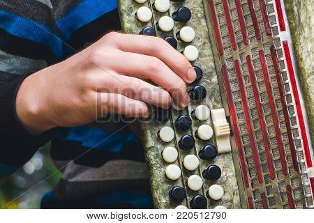 game on Bayan, close-up, hand and keys