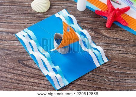 Craft Paper Boat, The Concept Of Father's Day Congratulation. Glue, Scissors, Paper, Starfish And Se