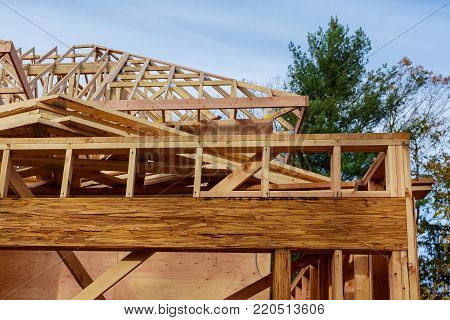 New build roof with wooden truss, post and beam framework. New home construction framing Timber frame house, real estate.