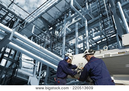 refinery workers inside large fuel and oil industry