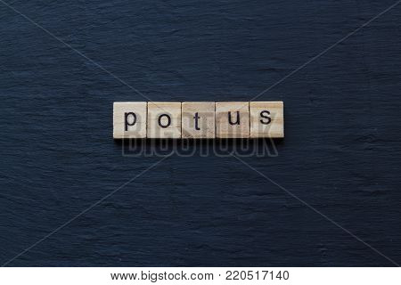 Toy wood letter blocks spelling out POTUS.